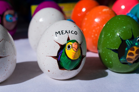 Mexican handicraft, parakeet comes out of the egg. 스톡 콘텐츠