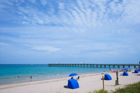 There is good weather on the beach of south palm beach.