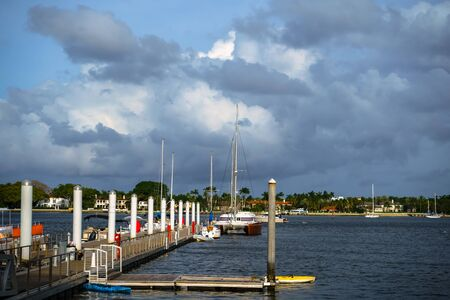 There is a catamaran on the pier in West Palm Beach, Florida.
