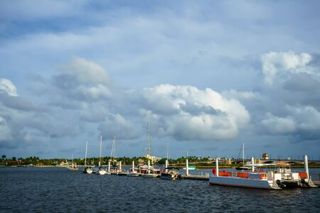 There are several types of boats at the pier in West Palm Beach, Florida. Фото со стока