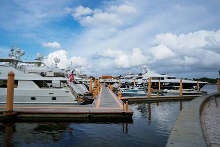 The yachts are stationed at the wharf in West Palm Beach, Florida. Imagens