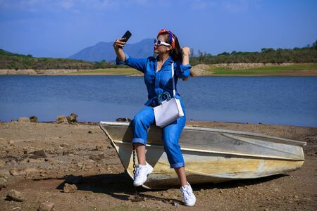 The young woman is taking self-care at the Corrinchis dam in Mascot Jalisco.
