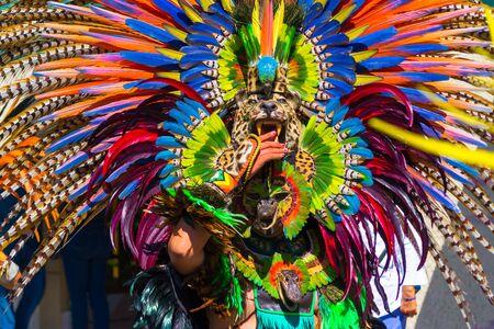 The dancer has a very striking animal pieces suit. Reklamní fotografie