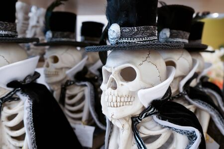 The skulls are dressed in cape and hat. Foto de archivo