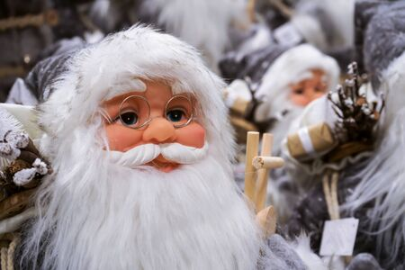 Santa Claus is dressed in gray clothes and has a very long beard. Stok Fotoğraf
