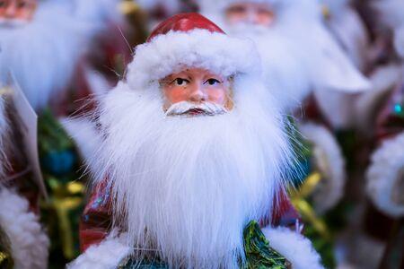 A man like Santa Claus has a very long white beard.