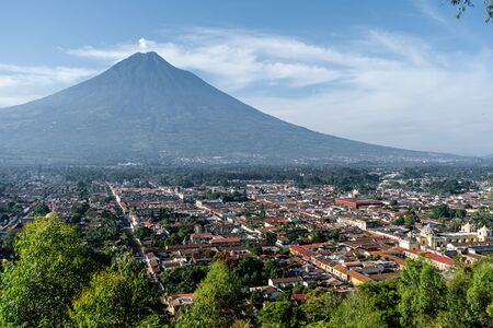 The city of Antigua in Guatemala at the foot of the Agua volcano.