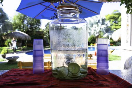 In the pool there is a jug with water, ice and lemons for everyone.