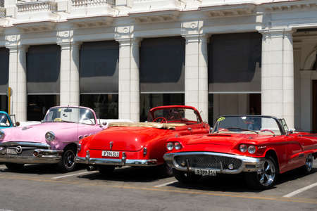 Havana, Cuba - August 25 2018: There are many classic tourist taxis parked on Agramonte street next to the Gran Hotel Manzana Kempiski in Old Havana.