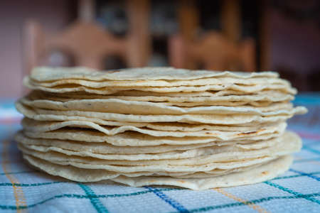 There is a kilo of corn tortillas on the table. 免版税图像