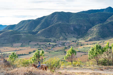 A man goes on horseback in the mountains of the town of Santa Rosa in the Municipality of Mascota Jalisco.