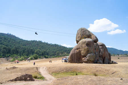 A young man travels on the zip line of the rocks of Tapalpa Jalisco Mexico.
