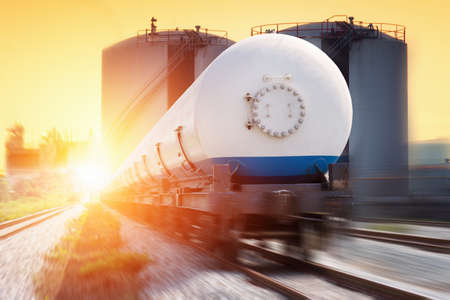 freight train: Tanks with gas being transported by rail at sunset