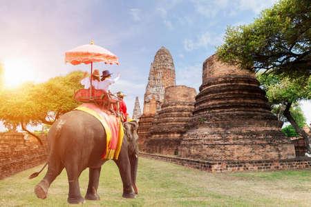 Tourists riding elephants in Ayutthaya,Thailand sunrise,sun light