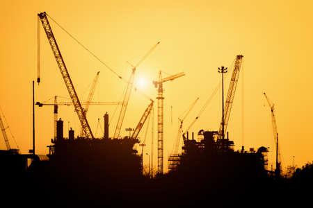 Silhouette construction site in sunset Foto de archivo