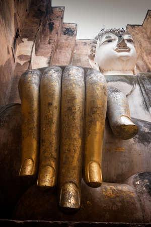 Close up hand of buddha in wat srichum at Sukhothai historical park.