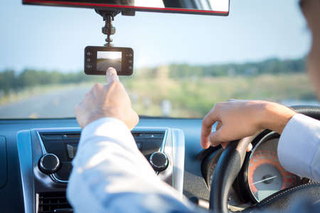 video recorder driving a car on highway Stock Photo