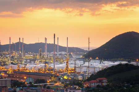 Aerial view oil refinery night with mountain background during twilight,Industrial zone,Energy power station.