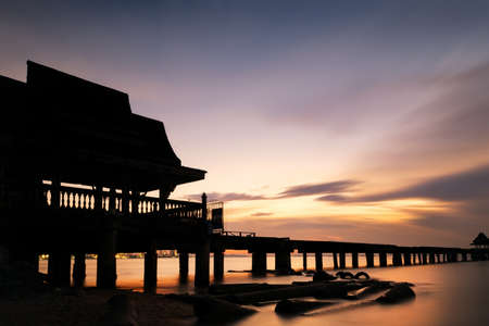 Twilight wood bridge at Djittabhawan Temple tourist attraction in Pattaya,Thailand