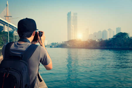 Photographer is taking a picture of sunset in bangkok Thailand. Foto de archivo