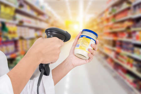 Supermarket Female cashier use code scanner, customer checkout