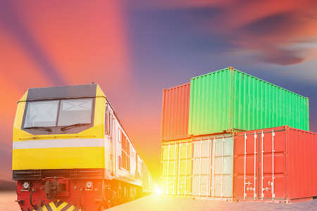 freight train: industry container trains running on railways track against beautiful sun set sky use for land transport and logistic business