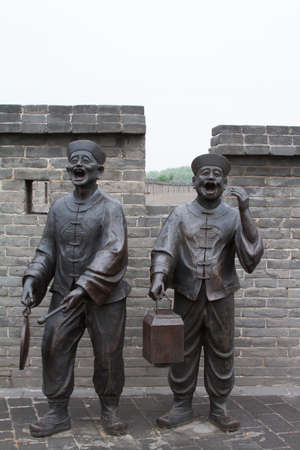briks: Two statues of Chinese announcing something that will start