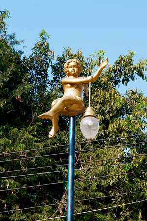 golden color angel lamp post thailand eletricty light