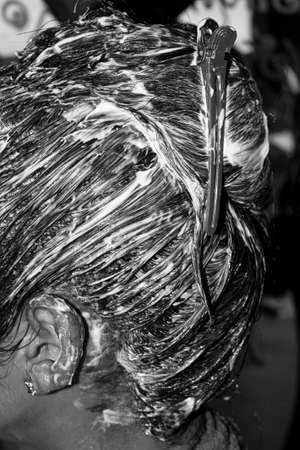 Moisturizing hair care application Hydration head close up  black white