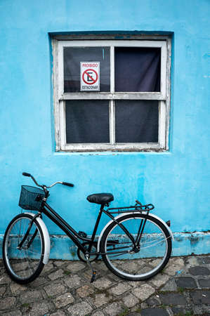 old bicycle basket parket window blue wall  parallelepiped