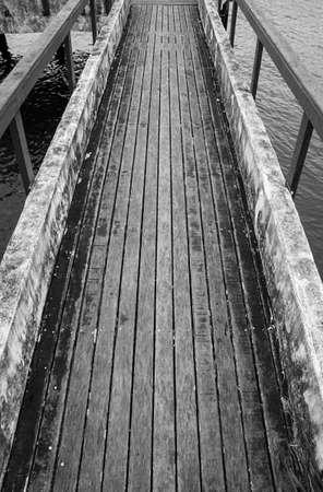 wooden cement footbridgewater sea aged rustic black white
