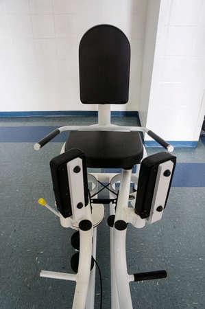 abduction  aduction machine indoors gym equipment