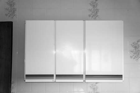 Kitchen cabinet rustic architecture on tiles wall in black and white