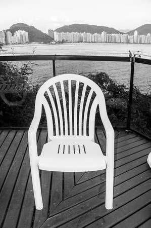 balcony plastic chair outdoor ocean view black white
