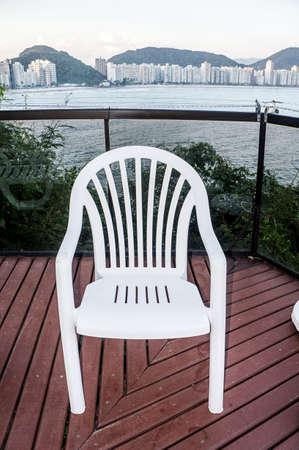 balcony plastic chair outdoor ocean view Stock Photo