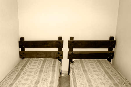wooden bed white wall bedroom    blanket  rustic vintage Stock Photo