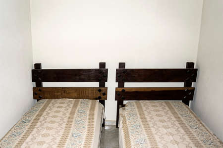 wooden bed white wall bedroom    blanket  rustic