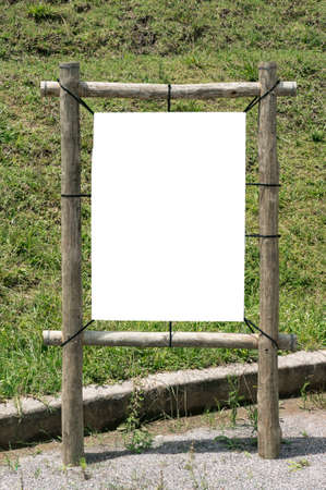 wooden  plaque sunny day empty blank grass outdoors Stock Photo