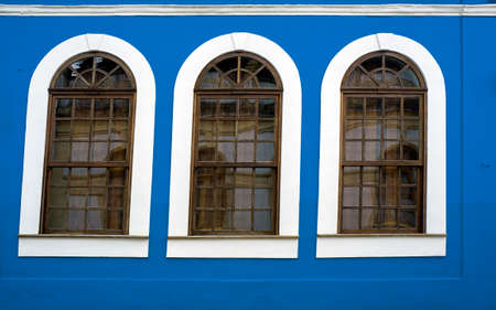 wooden framed windows  blue wall design  retro