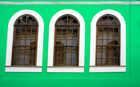 wooden framed windows  green wall design  retro Stock Photo