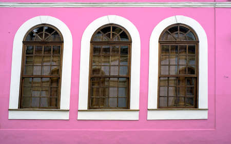 wooden framed windows  pink wall design  retro