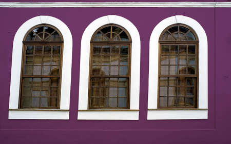 wooden framed windows  purple wall design  retro