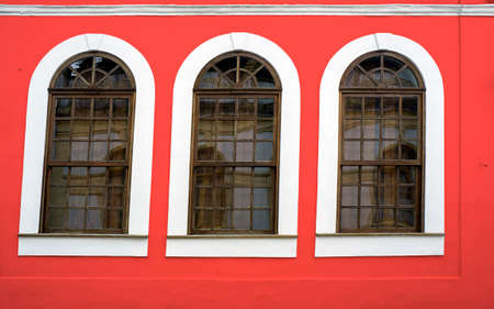 wooden framed windows  red wall design  retro