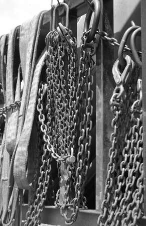scaled: grey scaled chains and belts Stock Photo