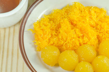 pinched: Gold egg yolks drops and Pinched gold egg yolks a kind of Thai Desserts