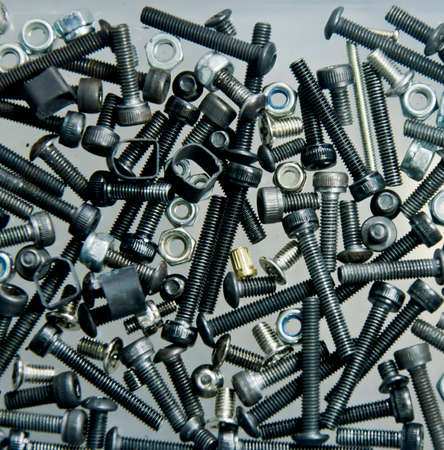 gudgeon: many Bolts, screws, nuts in tool box Stock Photo
