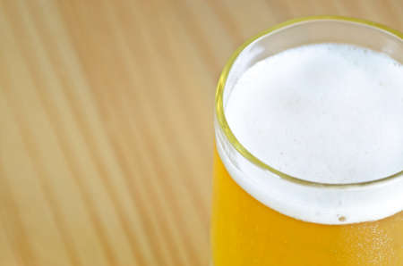 froth: Close up of beer glass with froth