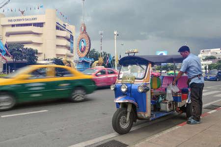 tuktuk: BANGKOK,THAILAND- OCTOBER 8 : Tuktuk and the driver at Rachadumneon Road, Bangkok, Thailand. Editorial