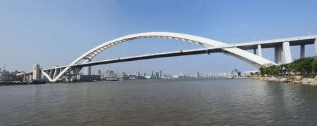shanghai lupu bridge from across the huangpu river  photo