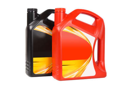 motor vehicle: two plastic bottle of engine oil on white background  Stock Photo